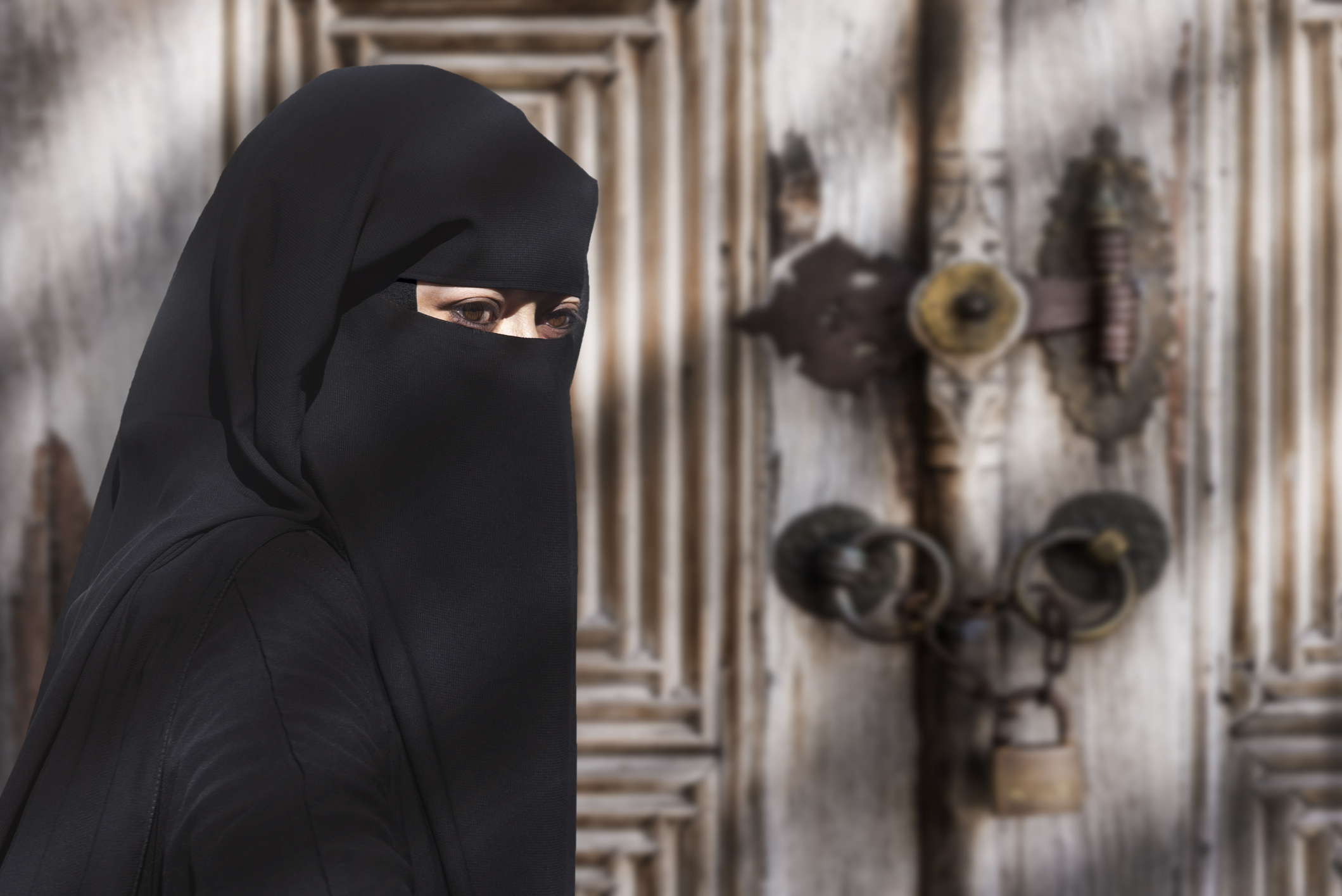 A mysterious Middle Eastern woman wearing a black Niqab.
